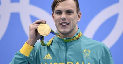 Australia's Kyle Chalmers poses with his gold medal on the podium of the Men's 100m Freestyle Final during the swimming event at the Rio 2016 Olympic Games at the Olympic Aquatics Stadium in Rio de Janeiro on August 10, 2016.   / AFP / Martin BUREAU        (Photo credit should read MARTIN BUREAU/AFP/Getty Images)